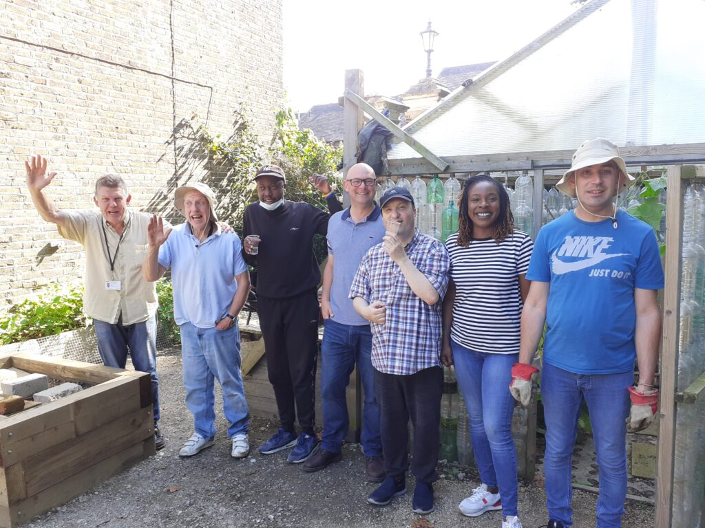 John, fourth from the left and Marcia from Galldris, join staff and clients from the LD project at our allotment